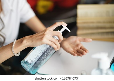 women washing hands with alcohol gel or antibacterial soap sanitizer after using a public restroom.Hygiene concept. prevent the spread of germs and bacteria and avoid infections corona virus