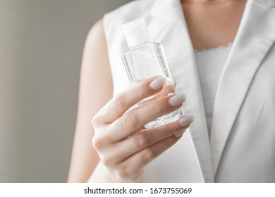 Women washing hands with antibacterial sanitizer gel. Hygiene concept. Prevent the spread of germs and bacteria and avoid infections corona virus. - Shutterstock ID 1673755069