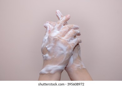 Women washing of hands with soap foam ,nice soft background