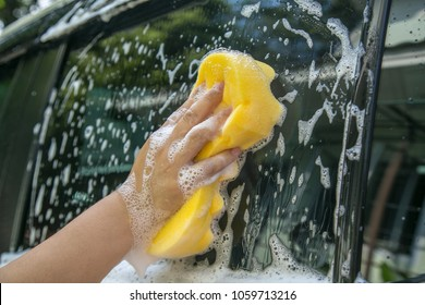 Women are washing their own car.