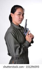 Women wear the jumpsuit was holding a revolver gun.