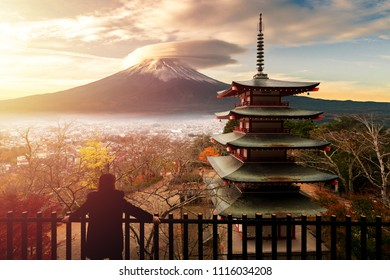 Women wear overcoat, She looking to the big fuji volcano at the chureito pagoda, Cold weather in the morning.