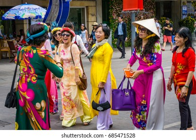 "Women wear traditional clothes/HoChiMinh, Vietnam – Jan 26 2017: These women wears ""Ao dai"". ""Ao dai"" is traditional clothes of Viet Nam. They were welcome a New Year, in HoChiMinh, Vietnam"