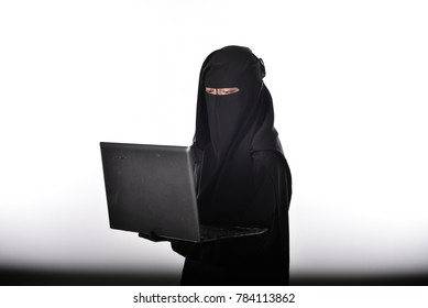 Women wearing niqab with hijab and use laptop