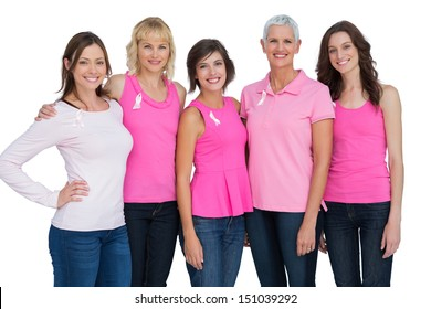 Women wearing pink for breast cancer awareness on white background