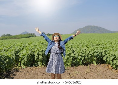 women wearing sunglasses Enjoyment. Free Happy Woman Enjoying Nature. Beauty Girl Outdoor. Freedom concept in sun flower tree field