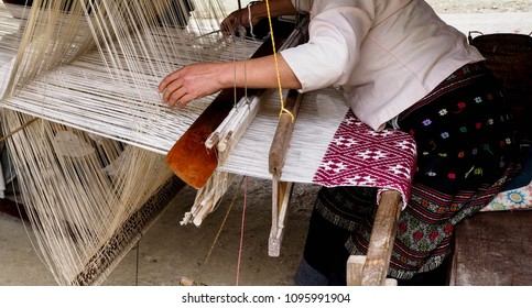 women weaving on a loom, real Local cotton and traditional Tai Lue Pattern in Poung Jong village, Nam Bak district, Luang Phabang, Laos