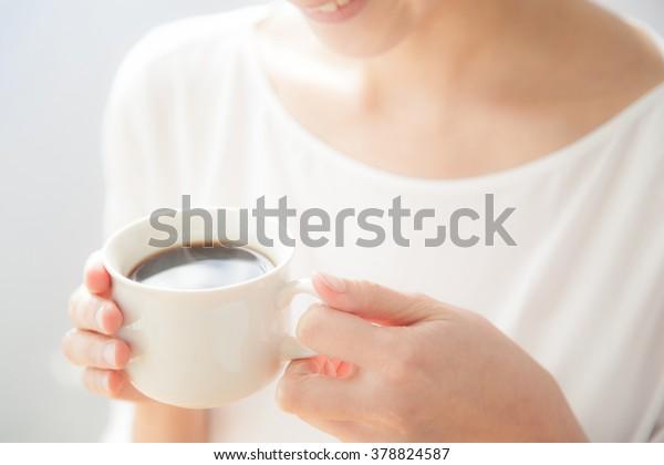 Women who drink coffee, smile, window