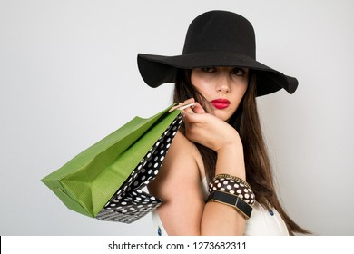 The women who is so happy cause she is doing shopping
