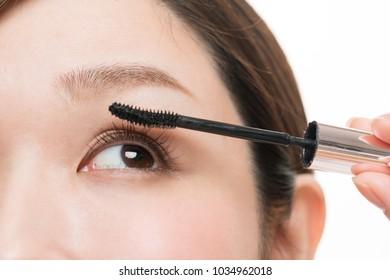 Women who make up makeup, eyelashes, mascara
