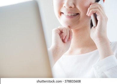 Women who make a phone call, laptop