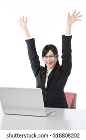 Women who work in the laptop , Businesswoman,smile,cheers