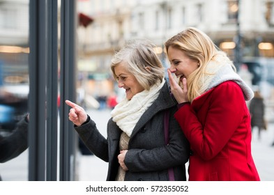 Women window shopping in centre of the city. Winter