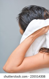 Women wipes her hair with towel, dry