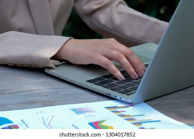 Women work in a beautiful business using a notebook while working with a business, working at an offsite desk.