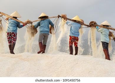 Women worker in salt production in Vietnam