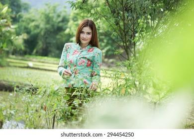 women working in her vegetable garden