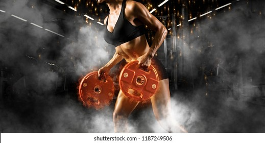 Women workout with disc barbell at gym