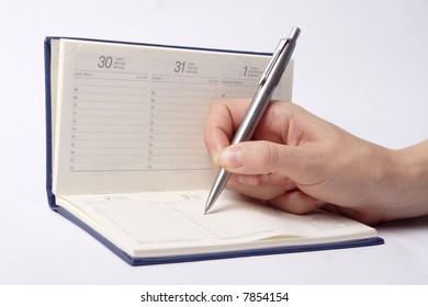 A women write a note