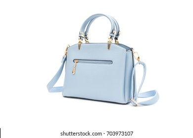 Women's accessories with blue handbags isolated on white background