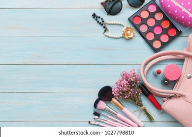 Women's accessories item with copy space on rustic blue wooden background, fashion and beauty concept