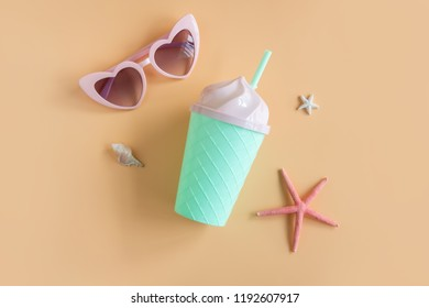 Women's accessories items and fancy glass on orange background, Summer vacation concept