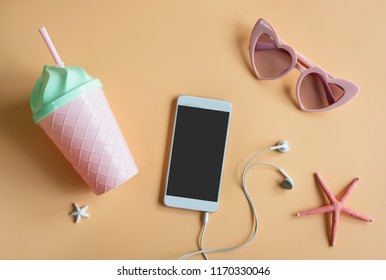Women's accessories items on colors background with smart phone, Summer vacation concept