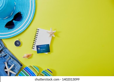Women's accessories summer travel on yellow background with blank space for text. Copy space, Flat lay