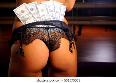 women's ass with dollars.