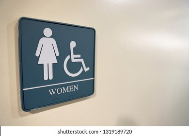 Women's bathroom symbol on wall, with room for text space, with handicapped symbol