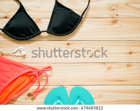 1a20fd2bdc Women's beachwear and accessories on wooden background. Beach clothing  concept. Copy space.
