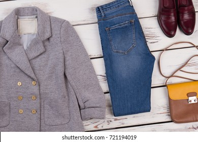 Women's blazer and skinny jeans combined with leather shoes and shoulder bag. Set of designer clothing, footwear and accessories.