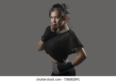Women's Boxing Training in sport bar with Gray Background