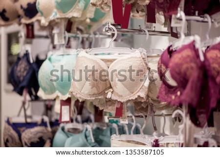 4833c94f009 Women s bras for sale in market. Vareity of bra hanging in lingerie  underwear store.
