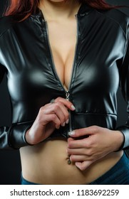 women's breasts in a leather jacket