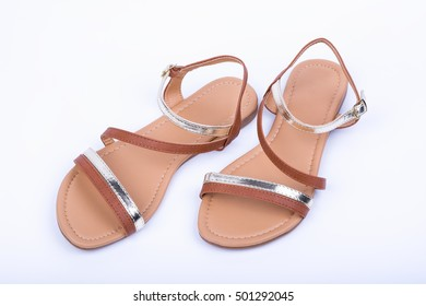 Women's brown sandals on white background. top view