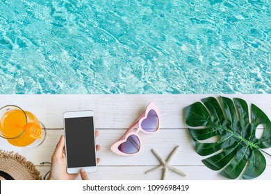 Women's casual clothes with accessories items and empty screen smart phone on white wooden background, Summer concept, Copy space