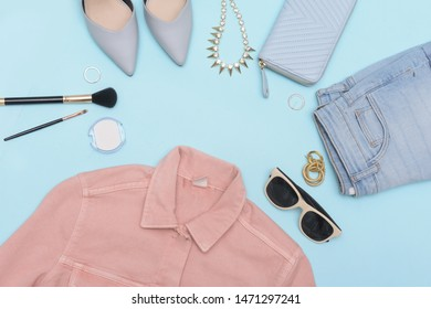 Women's casual clothes with accessories items , makeup on blue  background, Summer concept