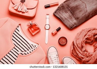 Women's clothes with accessories on living coral background