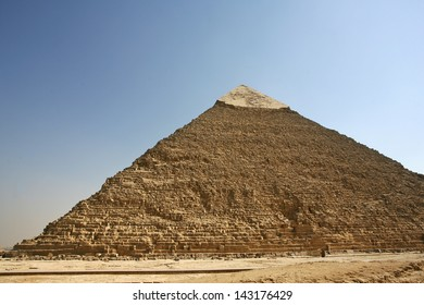 women's clothing and fashion, girls in skirts, Plateau (three pyramids known as Queens' Pyramids on front side; next in order from left: the Pyramid of Menkaure, Khafre and Chufu