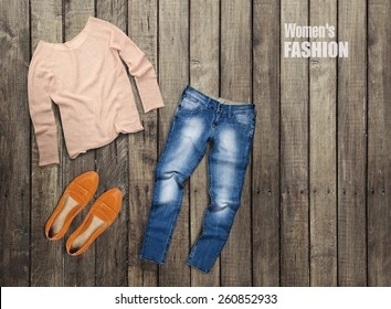 Women's clothing on a brown wooden background