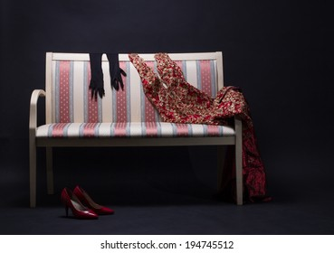 Women's clothing on the couch.