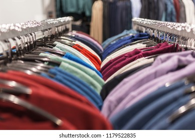 Women's clothing on hangers in the store
