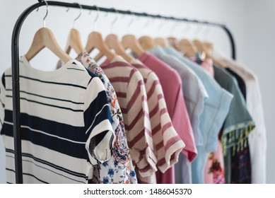 Women's clothing on clothing rack in white room