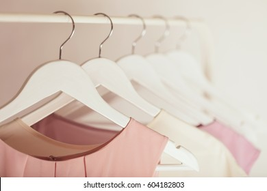 Women's clothing in pink tones on a white hanger. Selective focus