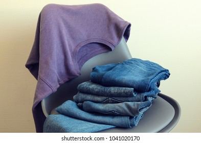 Womens clothing (violet sweatshirt, blue jeans). Outfit for teens. Trendy color