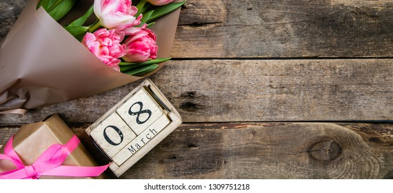 Women's day concept - calenday 8th march , present, flowers, copy space