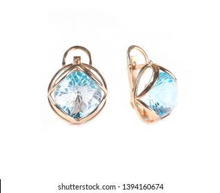 women`s earrings with stones isolated on a white background, golden earrings with stones, women`s jewelry, women`s accessories