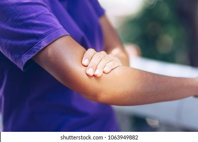 Women's elbow pain , A young woman touching her painful elbow , office syndrome , health care concept