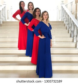 Women`s ensemble in beautiful concert dresses, vocal group, bandnconcert to the day of knowledge September 1, 2018. Vocal Studio charm Russia, city the eagle, the Palace square, 1